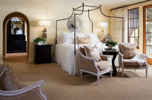 Carpet is comforting in a bedroom, where a neutral shade allows for design changes and avoids fading.