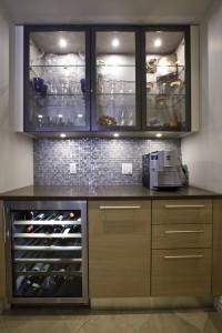A beverage center with glassware, wine cooler, refrigerated drawers and coffee maker makes parties a breeze.