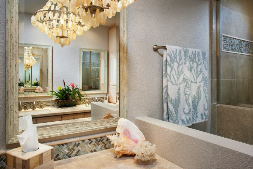 It's the small touches that matter — imagine how boring this bathroom remodel would have been if those strips of colorful tile had not been included.